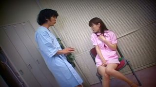 Sultry Japanese nurse Ai Himeno masturbates in the changing room sitting in front of the patient