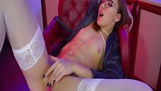 Tiny babe in stockings shoves thin sex toy in pussy in front of webcam
